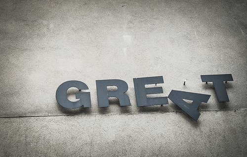 "The word ""Great"" nailed to a wall, with the letter ""A"" askew."