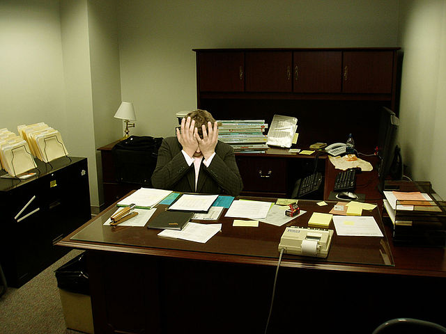 A frustrated man at a desk