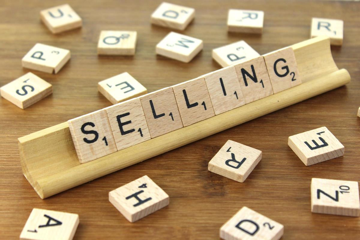 "A set of lettered tiles spelling the word ""Selling""."